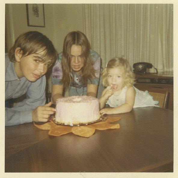 With my brother and sister and a birthday cake