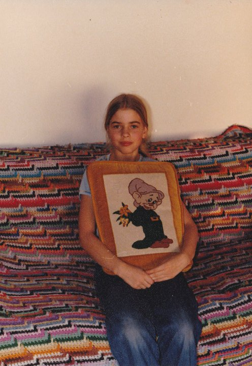 Me with my mom's needlepoint pillow