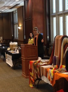 Standing with my crochet art display during the speech